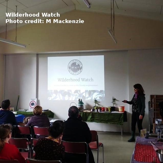 Attendees watching the Wilderhood Watch presentation.